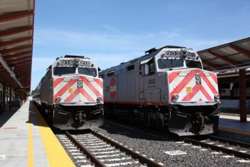Two trains on tracks at Caltrain station