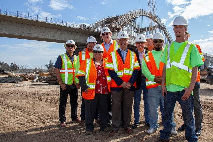 Congressman Jim Costa and group of officials and workers at San Joaquin River Viaduct construction site