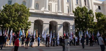 Native American Day at the California State Capitol, September 22, 2017. Flag bearers carry the flags of California's Tribal Nations in front of the California State Capitol in Sacramento. Photo by HSR.