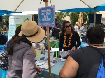 Visitors at Authority table at Disney Environmentality Earth Day event