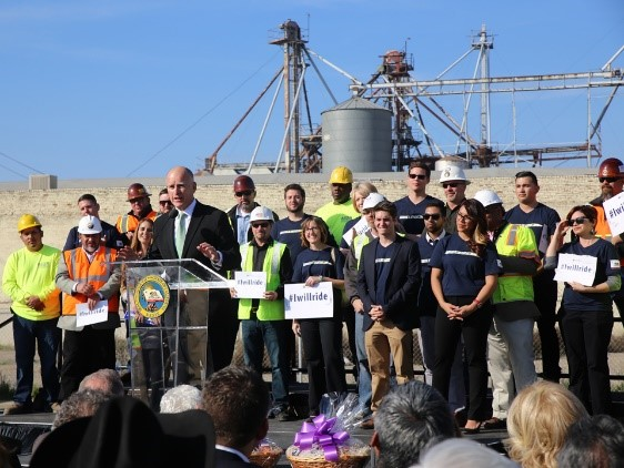 Former governor Jerry Brown speaks at a press conference during the high-speed rail construction groundbreaking alongside construction workers, advocates and I Will Ride students.