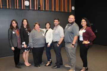 Former Central Valley regional director posses for a picture with a group of panelists in a student engineering presentation at UC Merced that connected female engineers with professionals in the Central Valley.