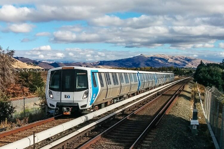 BART train travelling on tracks in the Bay Area