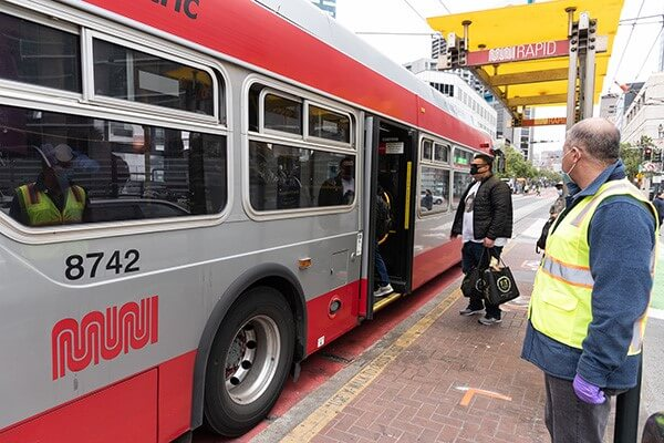 Muni bus in San Francisco with passengers boarding