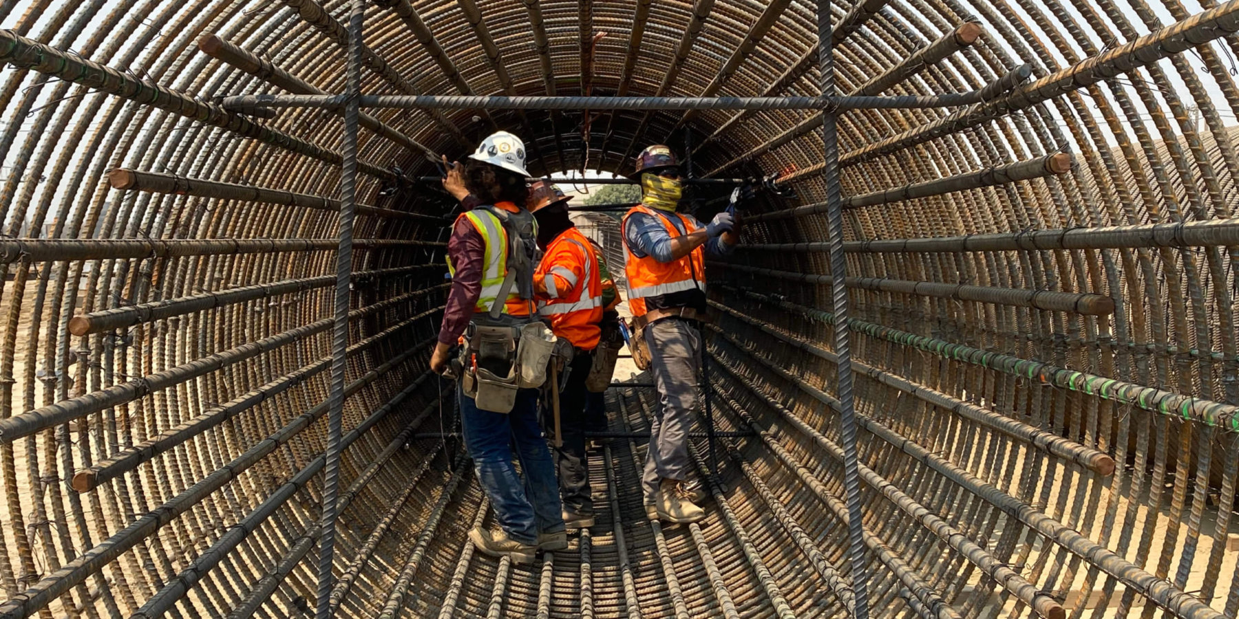 Workers tying rebar cage