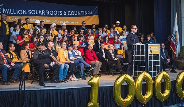 Rick Brown speaks at the One Million Solar Roofs and Counting celebration, December 2019