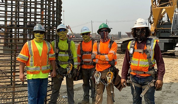 Group of construction workers with masks