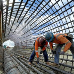 Workers at Conejo Avenue tying rebar cages
