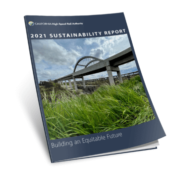 2021 Sustainability Report cover showing a bridge structure over a river with a field in the foreground